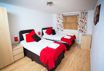 The secure premises features electric gate entry systems, and consists of a courtyard where you can park your car for only £6.00 a night in addition to your stay. This  two-bedroom serviced apartment