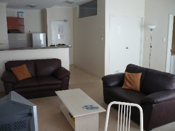 Hotel style complex, with outdoor, heated swimming pool and a gym. This apartment also offers an under-cover, secure car park at no extra charge.  This  two-bedroom serviced apartment is 70 sq.m ,  an
