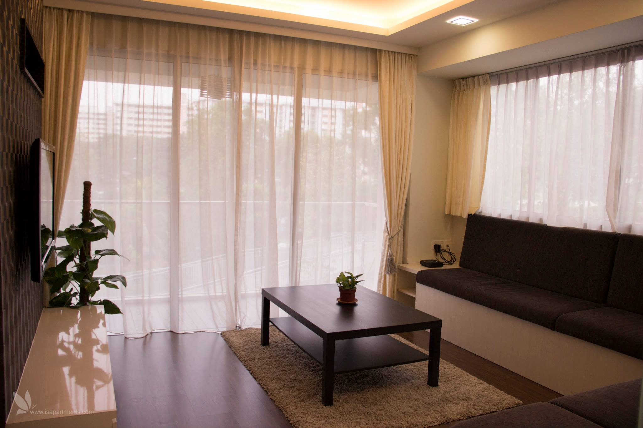 Facilities at The Parc Condo include a lap pool, spa pool, BBQ pits, gym, fitness station, and Jacuzzi.  This  two-bedroom serviced apartment is 1,200 sq.m ,  and can sleep 3 people maximum.  The apar