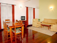 Saigon Village is a mix of villas and apartments located in a nice compound with gardens and facilities,(tennis, swimming-pool, etc...) This  four-bedroom serviced apartment is 170 sq.m ,  and can sle